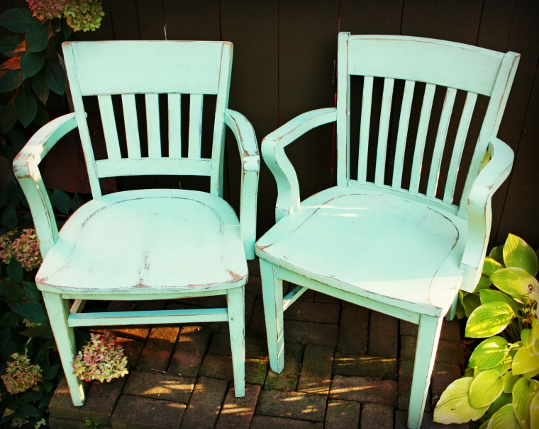 pair of aqua chairs.