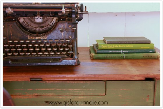Farmhouse table with vintage typewriter and books