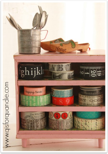 Washi tape stored in vintage pink toy dresser.