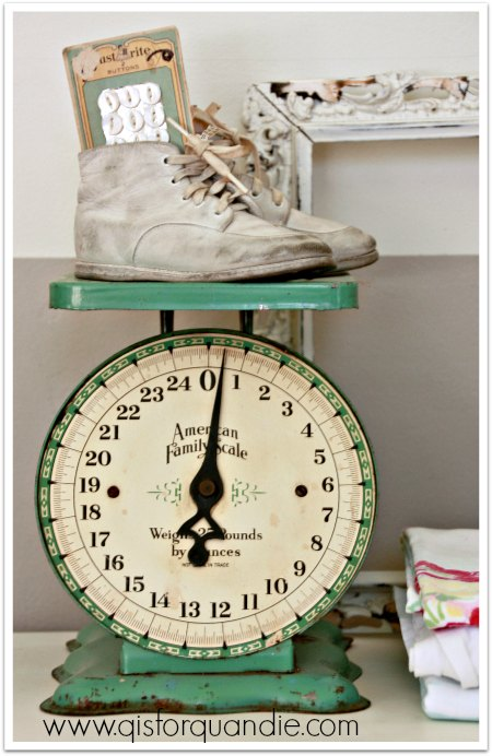 vintage scale with baby shoes
