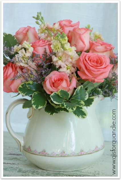 roses in pitcher