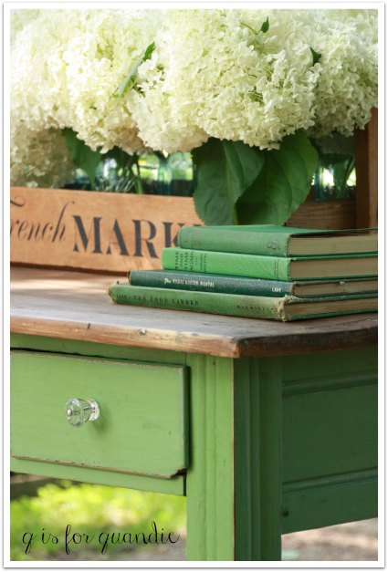 green desk and books