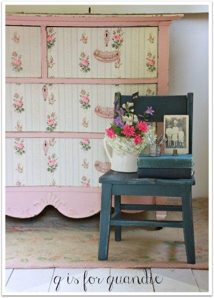 pink wallpapered dresser