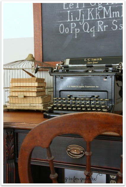 black desk and typewriter