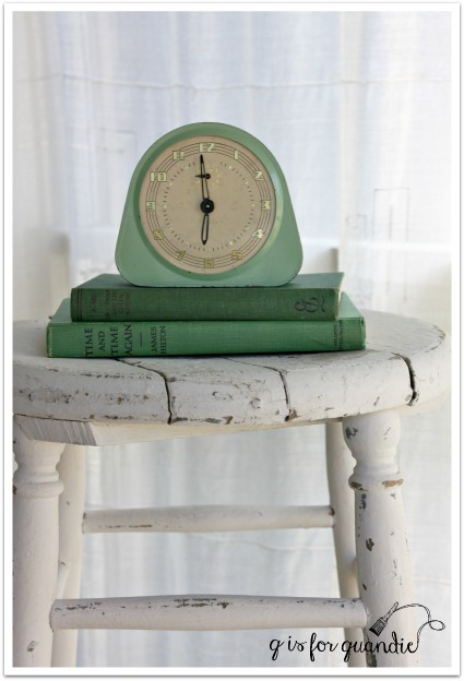 stool with books and clock