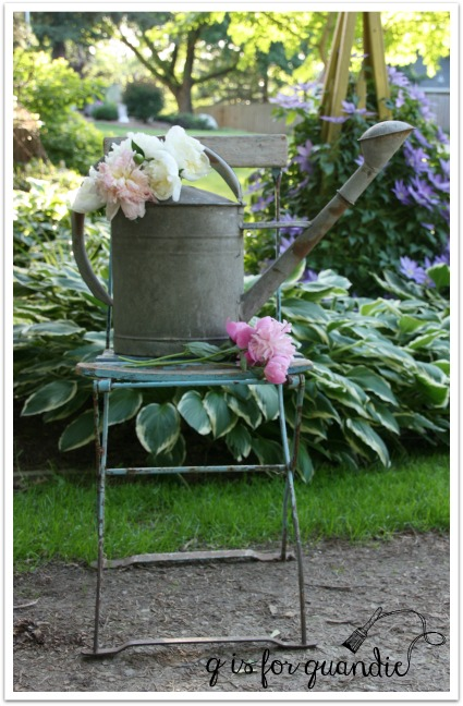 peonies and watering can