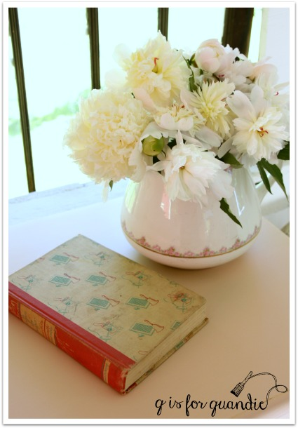 pink peonies with book