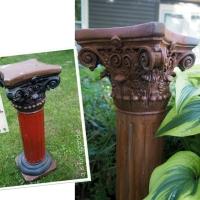 a rusty garden pedestal.